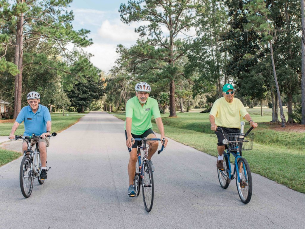 guys riding on bicycles on streets of Penney Retirement Community