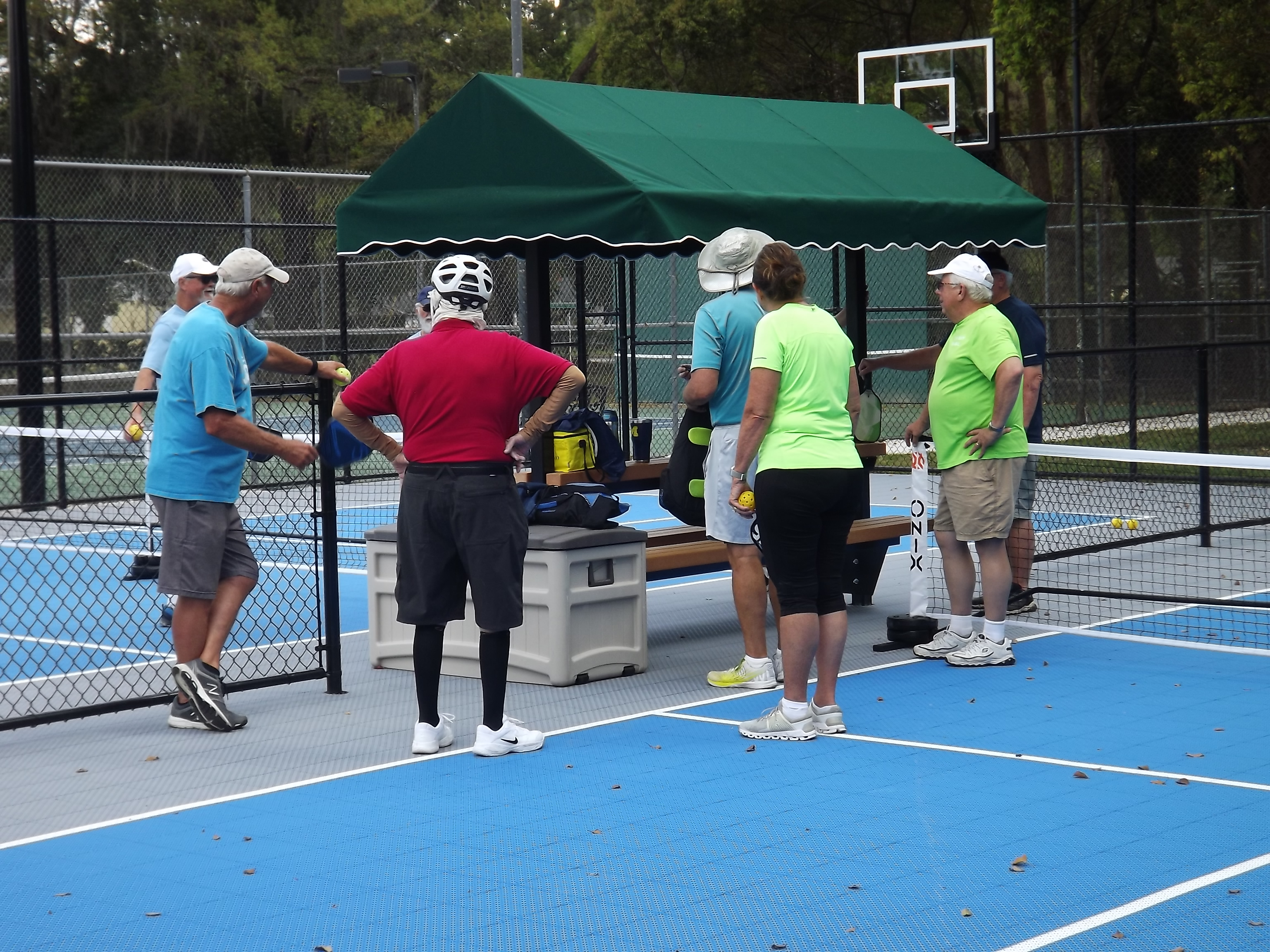 Enthusiasts waiting to play pickle ball